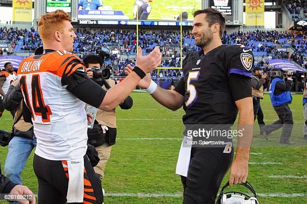Cincinnati Bengals quarterback Andy Dalton greets Baltimore Ravens quarterback Joe Flacco following the game on November 27 at MT Bank Stadium in...