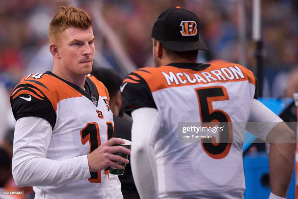Cincinnati Bengals quarterback Andy Dalton (14) talks to Cincinnati Bengals quarterback AJ McCarron (5) on the sidelines during the NFL preseason game between the Cincinnati Bengals and Indianapolis Colts on August 31, 2017, at Lucas Oil Stadium in Indianapolis, IN.