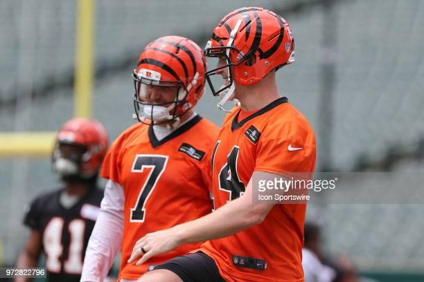 Cincinnati Bengals quarterback Andy Dalton talks with Matt Barkley during Bengals minicamp on June 12th 2018 at Paul Brown Stadium in Cincinnati OH