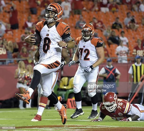 Cincinnati Bengals quarterback Matt Scott high steps into the end zone on a twopoint conversion in the fourth quarter against the Kansas City Chiefs...