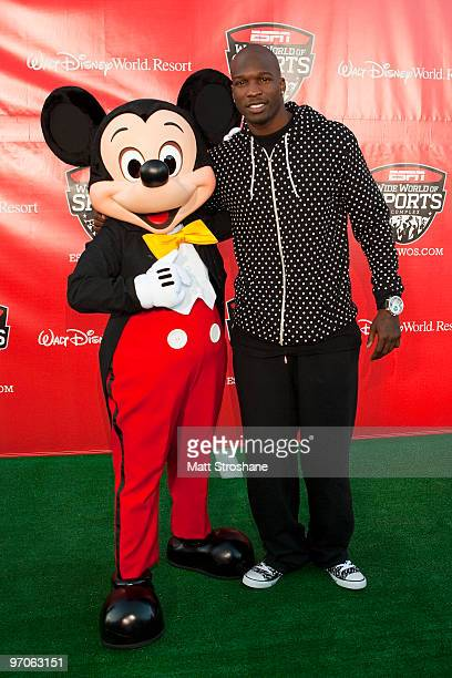Cincinnati Bengals receiver Chad Ochocinco walks the red carpet with Mickey Mouse at the official relaunch of the ESPN Wide World of Sports at Walt...