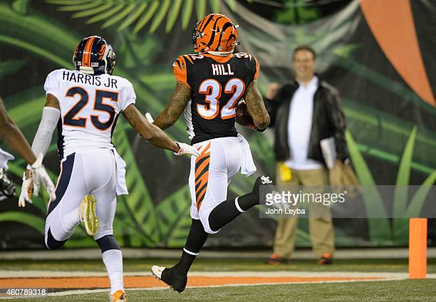 Cincinnati Bengals running back Jeremy Hill gets to the end zone on an 85 yard touchdown run during the first quarter December 22 2014 at Paul Brown...