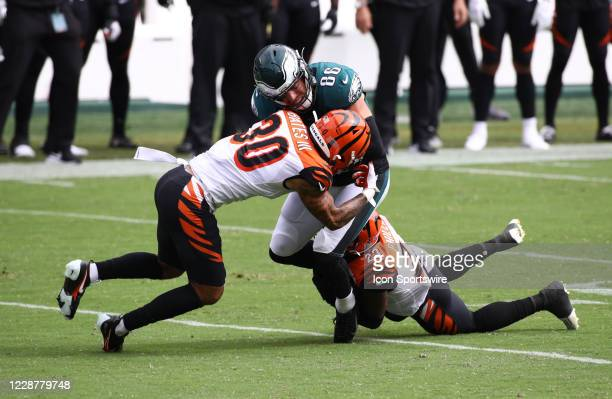 Cincinnati Bengals Safety Jessie Bates III and Cornerback Darius Phillips tackle Philadelphia Eagles Tight End Zach Ertz in the first half during the...