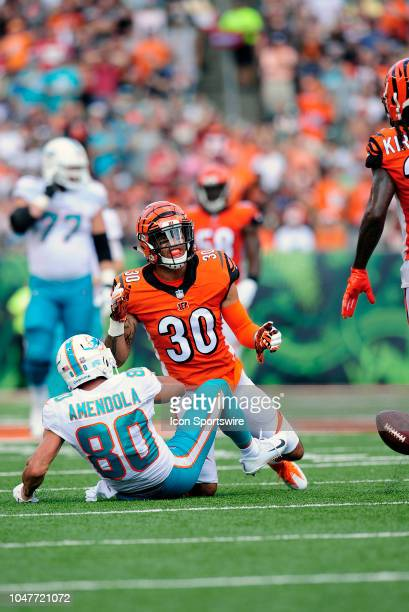Cincinnati Bengals Safety Jessie Bates knocks the blal away from Miami Dolphins Wide Receiver Danny Amendola during an NFL game between the Miami...