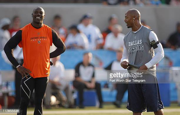Cincinnati Bengals' Terrell Owens left and Dallas Cowboys wide receiver Patrick Crayton talk before the annual Hall of Fame football game in Canton...