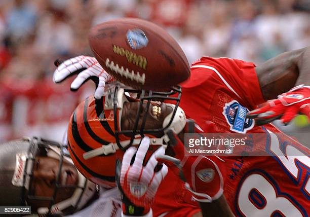 Cincinnati Bengals wide receiver Chad Johnson battles for a pass February 12 2006 at the Pro Bowl at Aloha Stadium in Honolulu