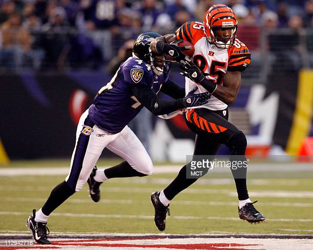 Cincinnati Bengals wide receiver Chad Johnson makes a reception before Baltimore Ravens cornerback Willie Gaston during first half action at MT Bank...