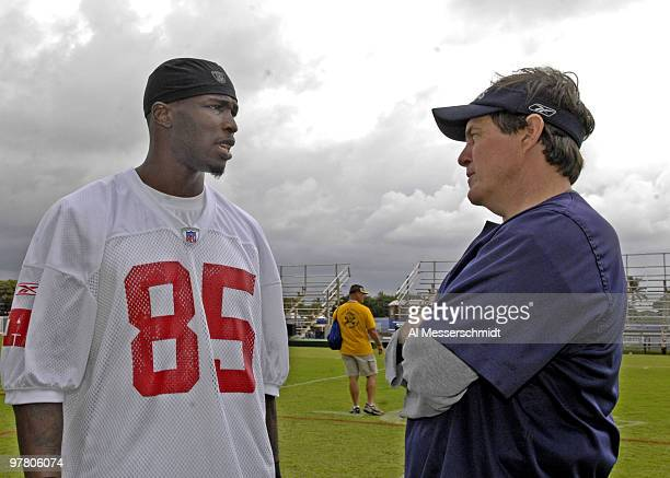 Cincinnati Bengals wide receiver Chad Johnson talks with New England Patriots coach Bill Belichick after an AFC practice Feb 7 for the 2007 Pro Bowl...