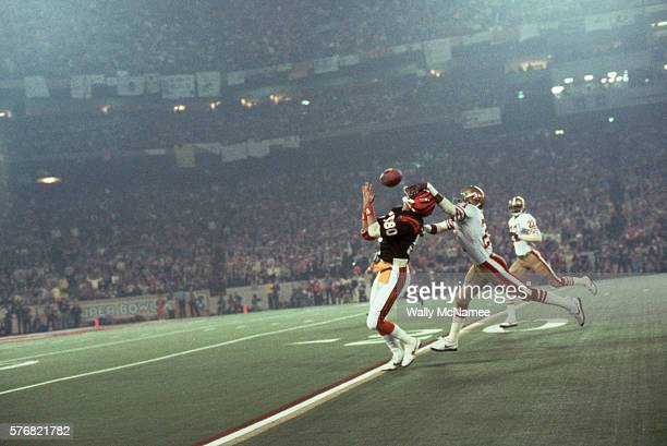 Cincinnati Bengals' wide receiver Cris Collinsworth looks up to catch the football only to be interfered with by a San Francisco 49er during Super...