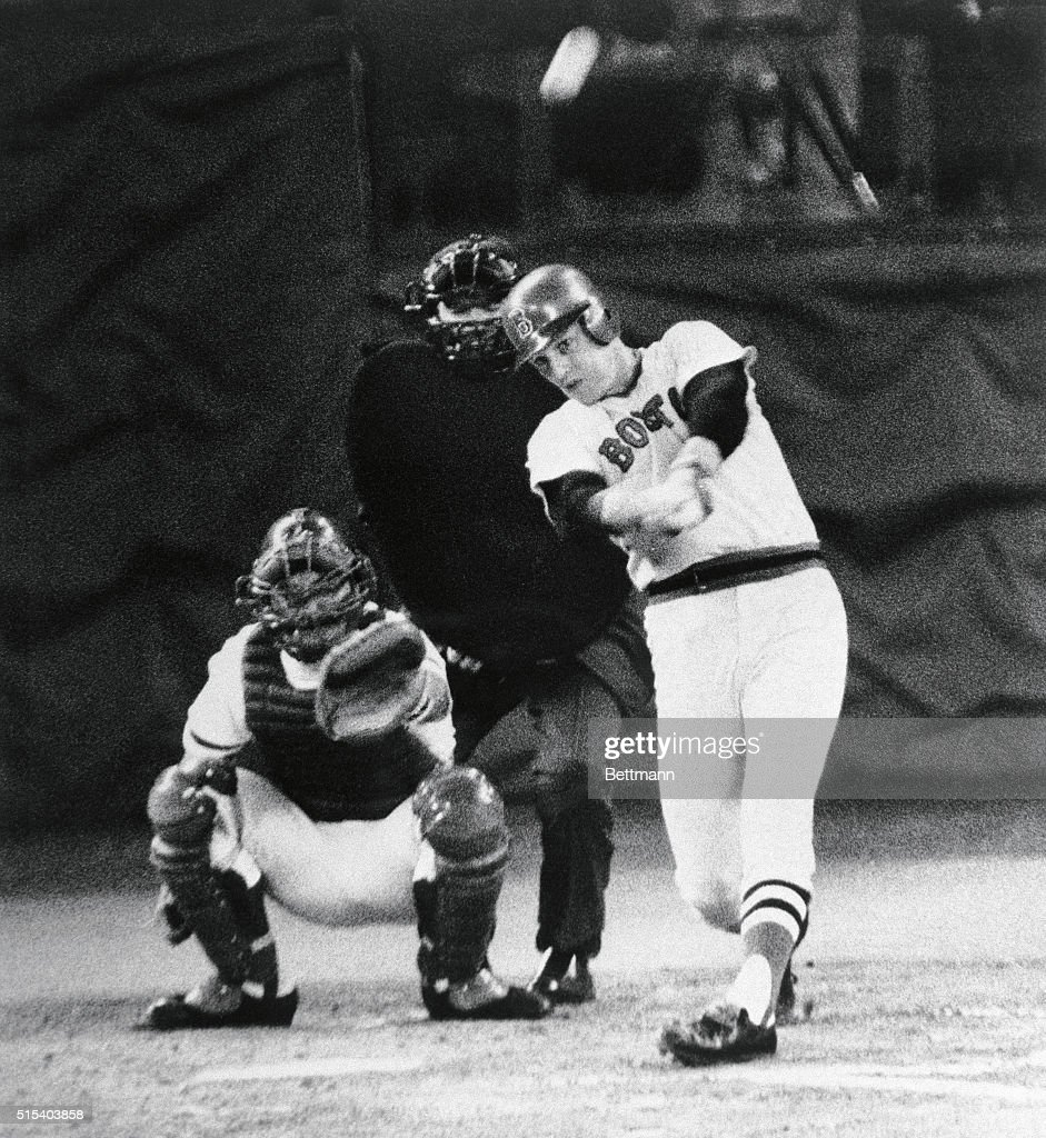 Carlton Fisk of the Red Sox connects for a home run in the second inning against the Reds October 14 in game 3 of the World Series. Catcher is Johnny Bench; umpire Larry Barnett.