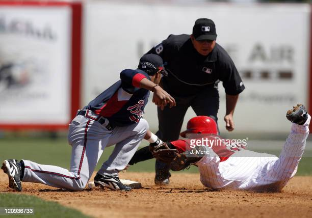Cincinnati catcher David Ross is tagged out by Atlanta's Tony Pena on this play during Sunday's action at Ed Smith Stadium in Sarasota, Florida on...