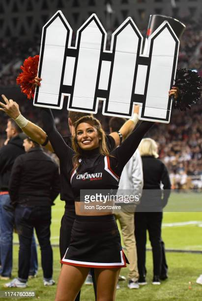 Cincinnati cheerleader holds a defense sign during a college football game between the University of Central Florida Knights and Cincinnati Bearcats...