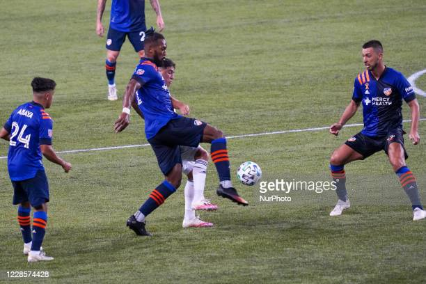 FC Cincinnati defender and team captain Kendall Waston clears the ball from goal during a MLS soccer match between FC Cincinnati and the Chicago Fire...