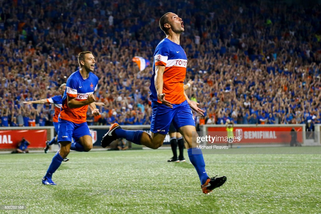 FC Cincinnati defender Austin Berry celebates after scoring a goal in the second half against the New York Red Bulls during the semifinal match of the 2017 Lamar Hunt U.S. Open Cup at Nippert Stadium on August 15, 2017 in Cincinnati, Ohio.