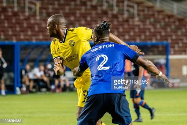 FC Cincinnati defender Kendall Waston and Columbus Crew forward Fandendo Aid compete for position during a MLS soccer match between FC Cincinnati and...