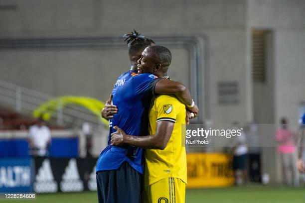 FC Cincinnati defender Kendall Waston and Columbus Crew forward Fanendo Aid embrace one another dafter the MLS soccer match between FC Cincinnati and...