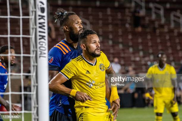 FC Cincinnati defender Kendall Waston and Columbus Crew midfielder Artur compete for position at the goal during a MLS soccer match between FC...
