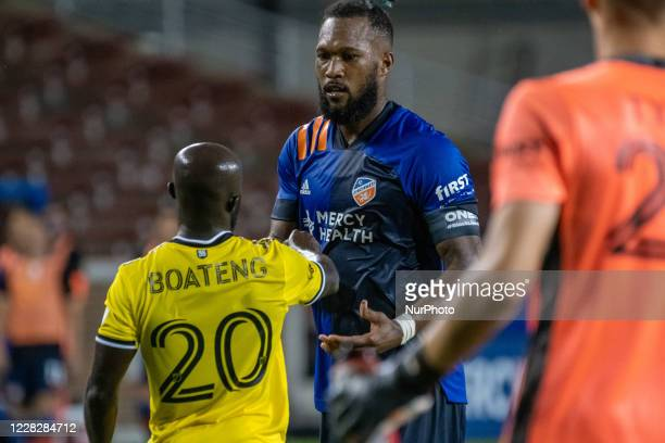 FC Cincinnati defender Kendall Waston and Columbus Crew midfielder Emmanuel Boateng congratulate one another at the end of the MLS soccer match...