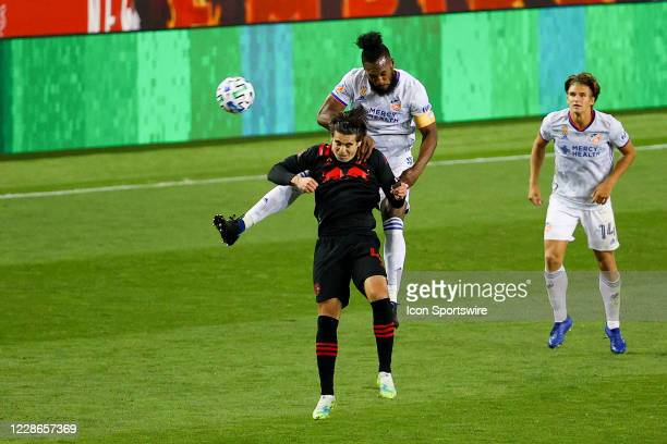 Cincinnati defender Kendall Waston battles New York Red Bulls forward Brian White during the Major League Soccer game between the New York Red Bulls...