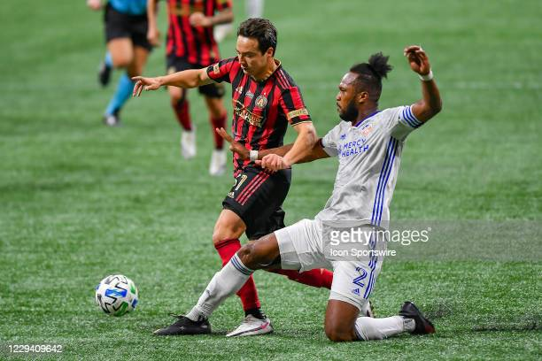 Cincinnati defender Kendall Waston challenges Atlanta United forward Erick Torres during the MLS match between FC Cincinnati and Atlanta United FC on...