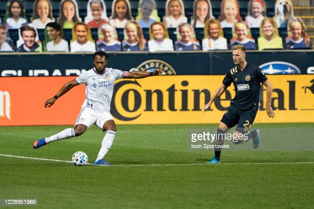 Cincinnati Defender Kendall Waston kicks the ball with Philadelphia Union Forward Kacper Przybylko in pursuit during the first half of a Major League...