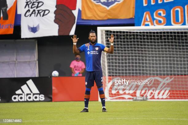 FC Cincinnati defender Kendall Waston pauses during a moment of silence prior to the start of the MLS soccer match between FC Cincinnati and the...