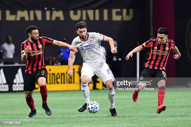 Cincinnati defender Mathieu Deplagne dribbles the ball by Jake Mulraney during the match against Atlanta United, which Atlanta won, 2-1, in front of...
