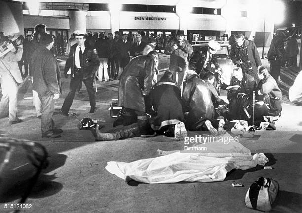 Cincinnati: Firemen work frantically over several youths who were believed trampled outside the Riverfront Coliseum when hundreds of fans rushed the...