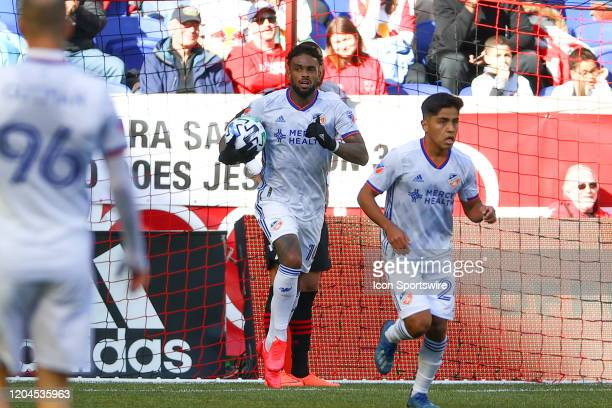 Cincinnati forward Jurgen Locadia gets the ball out of the goal after he scores during the second half of the Major League Soccer game between the...