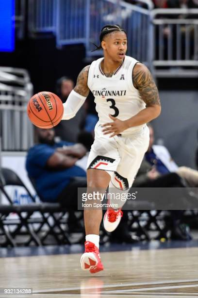 Cincinnati guard Justin Jenifer dribbles up court during the first half of the AAC Men's Basketball Conference Tournament game between Cincinnati and...
