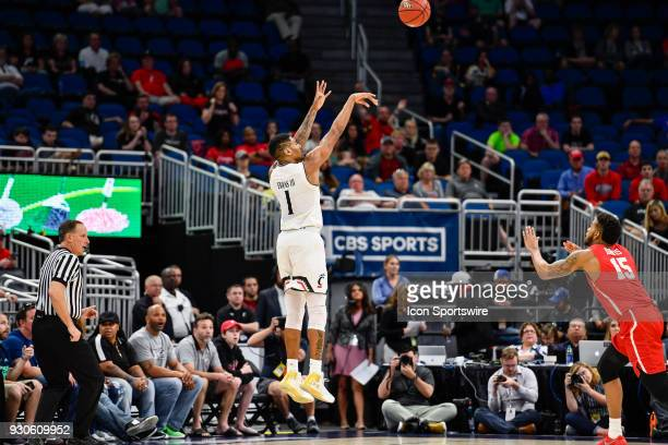 Cincinnati guard/forward Jacob Evans III takes a shot from outside during the second half of the AAC Men's Basketball Conference Tournament...