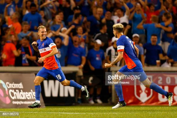 Cincinnati midfielder Corben Bone celebrates with Aodhan Quinn after scoring a goal in the first half against the New York Red Bulls during the...