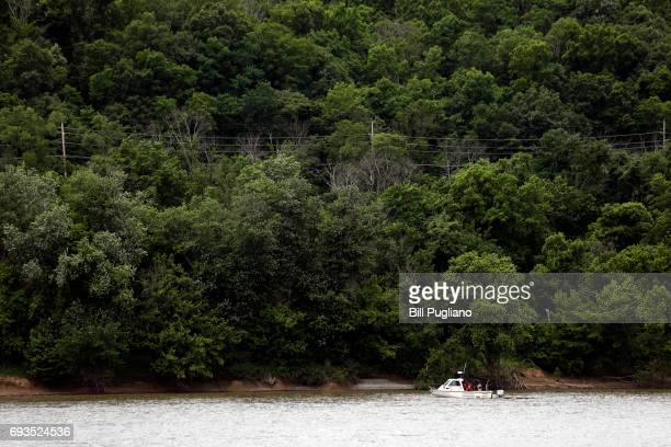 Cincinnati Police boat patrols the Ohio River shoreline near where U.S. President Donald Trump will speak about transportation infrastructure...
