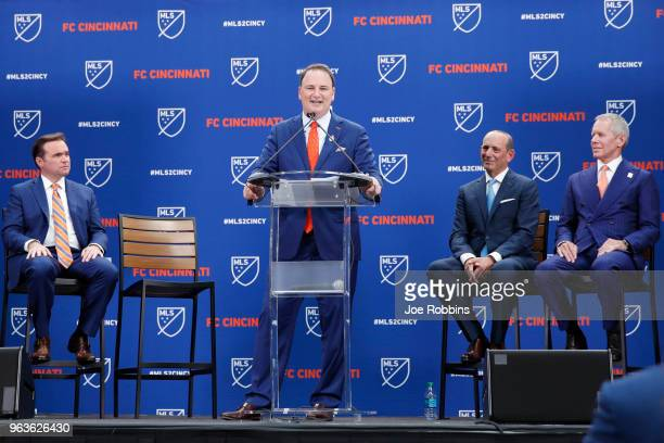 Cincinnati president and general manager Jeff Berding speaks as principal owner Carl Lindner III, MLS commissioner Don Garber and Cincinnati mayor...