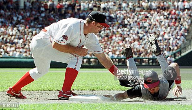 Cincinnati Reds base runner Aaron Boone dives back to first base ahead of the tag by Cleveland Indians first baseman Jim Thome to avoid the pickoff...