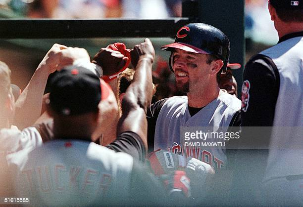 Cincinnati Reds catcher Eddie Taubensee is congratulated by teammates in the dugout following his eighth inning two run home run off of Cleveland...