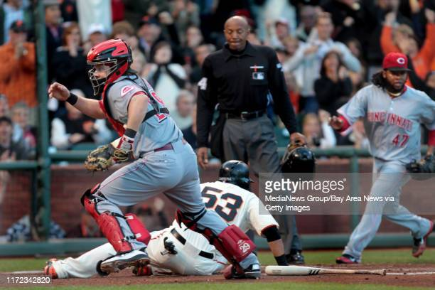 Cincinnati Reds' catcher Ryan Hanigan goes after the ball as San Francisco Giants' Melky Cabrera scores on Angel's Pagan's double in the second...