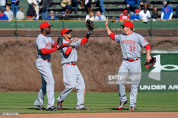 Cincinnati Reds center fielder Billy Hamilton and Cincinnati Reds right fielder Jay Bruce celebrate in action during a game between the Cincinnati...