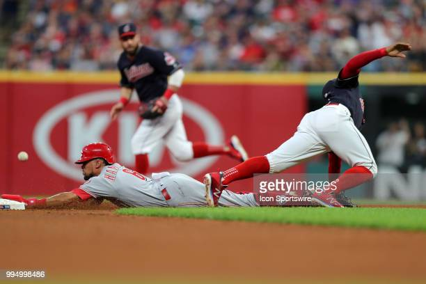 Cincinnati Reds center fielder Billy Hamilton is safe at second with a stolen base as the throw from Cleveland Indians catcher Yan Gomes gets past...