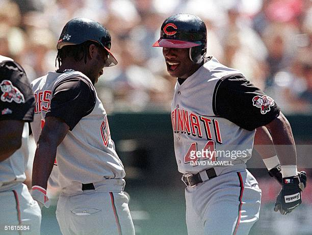 Cincinnati Reds center fielder Mike Cameron celebrates with teammate Pokey Reese following his eighth inning two run home run off of Cleveland...