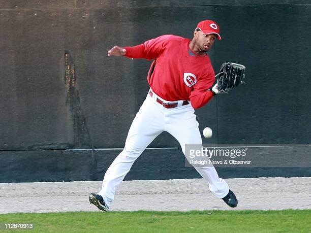 Cincinnati Reds' Darnell McDonald drops a fly ball in center field during an exhibition game against the top prospects in their farm system during...