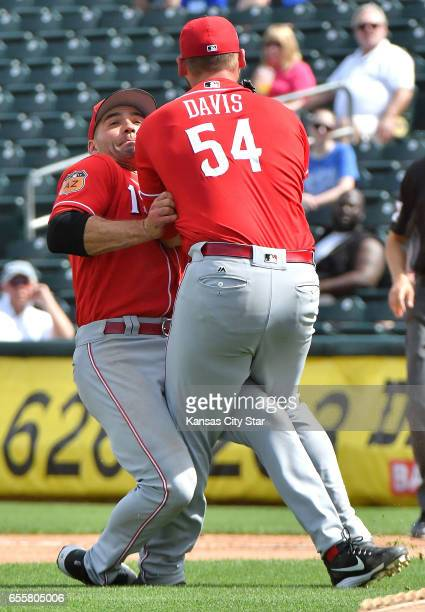Cincinnati Reds first baseman Joey Votto and starting pitcher Rookie Davis collide on an infield pop up for an out on Kansas City Royals' Whit...
