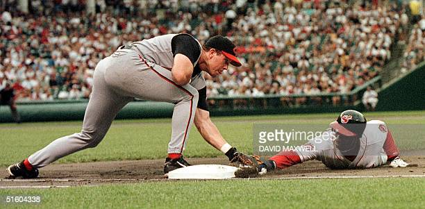 Cincinnati Reds first baseman Sean Casey tags Cleveland Indians center fielder Kenny Lofton out at first base in the first inning 09 July 1999 at...