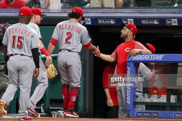 Cincinnati Reds infielder Alex Blandino is congratulated by Cincinnati Reds third baseman Eugenio Suarez after Blandino pitched the eighth inning of...