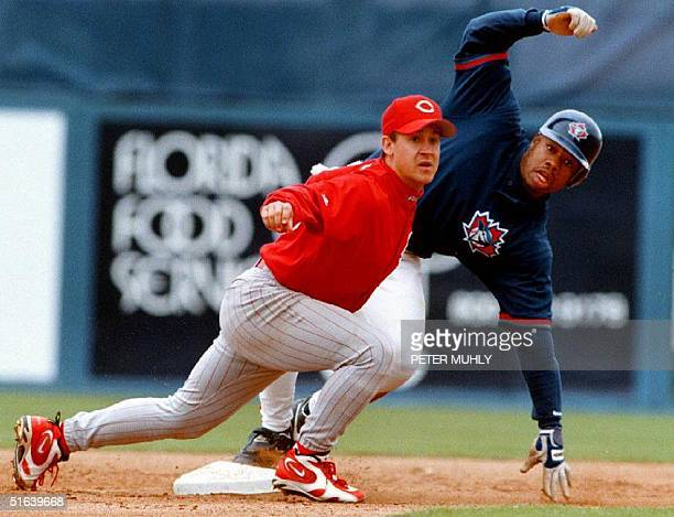 Cincinnati Reds infielder Bret Boone looks for the umpire's call as Toronto Blue Jays outfielder Shannon Stewart steals second base during the fifth...
