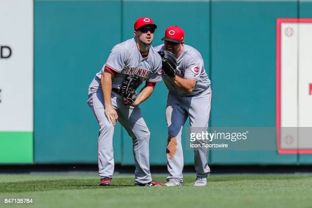 Cincinnati Reds left fielder Adam Duvall left gets a pat on the back from Cincinnati Reds center fielder Scott Schebler right after making a close...