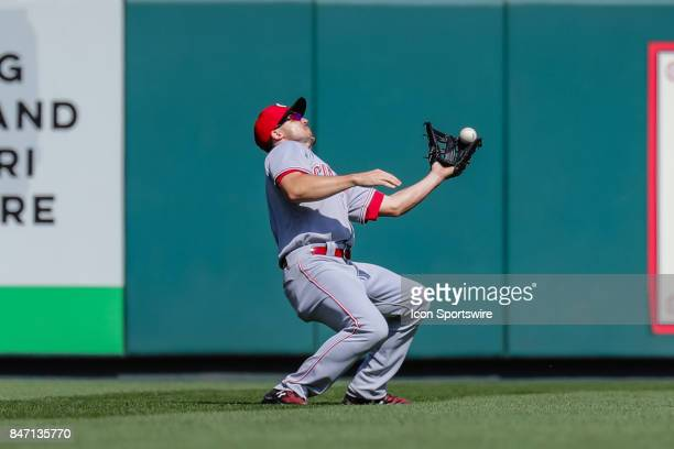 Cincinnati Reds left fielder Adam Duvall recovers and makes the catch on a fly ball during the fifth inning of a baseball game against the St Louis...