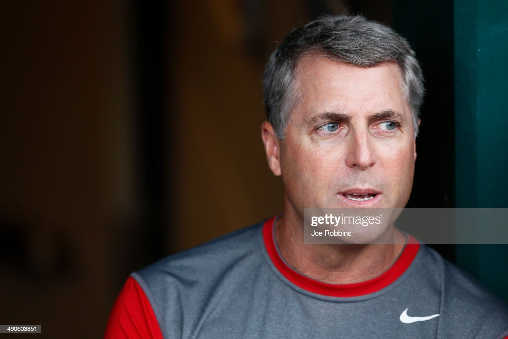 Cincinnati Reds manager Bryan Price looks on from the dugout as the start of the game against the San Diego Padres is delayed by rain at Great American Ball Park on May 14, 2014 in Cincinnati, Ohio.