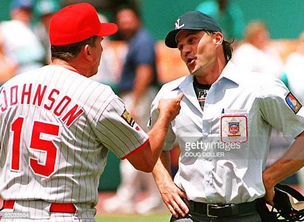 Cincinnati Reds Manager Davey Johnson argues a call with umpire Bill Hohn after Hohn warned Reds pitcher Tim Pugh for intentionally hitting Florida...