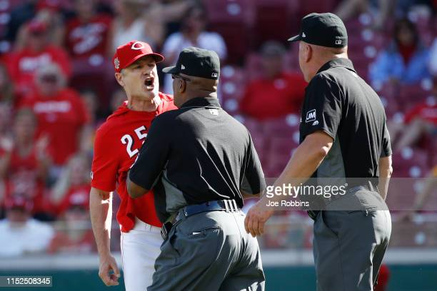 Cincinnati Reds manager David Bell is restrained by first base umpire Laz Diaz after being ejected from the game by crew chief Jeff Nelson in the...